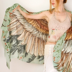 Shovava Wings Scarves, by Australia-based artist Roza Kamitova, each gorgeous and elegant piece covered with hand drawn paintings and prints.