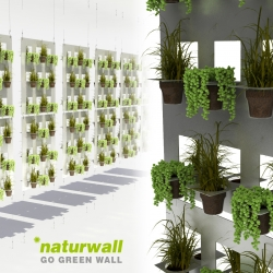 Naturwall is a vertical green wall that reuses disposable coffee and tea cups as plant pots. Ten or more pieces of used plastic cups were collected and put in a very simple flexible metal holder system.