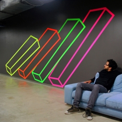 Facebook recently commissioned artist Aakash Nihalani for tape installations in their new office in New York.