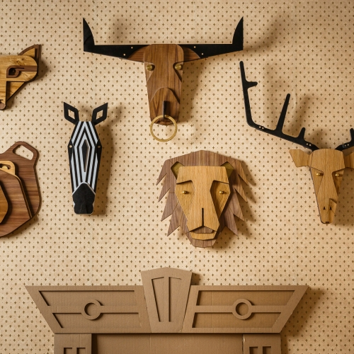 Urban Masquerade - A collection of laser cut wooden animal heads. A modern, humorist take on the traditional hunter's wall