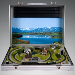 "Noch aluminum brief case with ""Blumenau"" model train set with a high-quality ready assembled summer landscape. Paul Smith used to take this train set to Japan on his early trips and would produce it at meetings when he became bored."