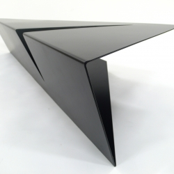 Lime Studio's coffee table looks impossible from the first angle. A metal coffee table exploring triangular shapes creating a piece of expressive furniture for the domestic interior.