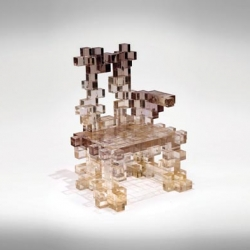 Presenze collection by Studio Nucleo uses resin to create furniture such as consoles, desks, and fireplace chairs.