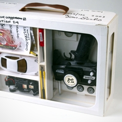 'Nutsy's Deluxe Racing Set' by Tom Sachs edition of 150. This kit gives you everything you need to drive on Nutsy's racetrack (or anywhere you deem suitable for a Mini-Z racer).