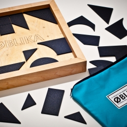 Oblika, is a puzzle composed of 22 geometric wooden pieces designed by Jonathan Dorthe. The puzzle can be assembled in many different ways, a world of possibilities!