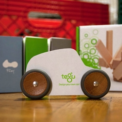 Tegu now has WHEELS! Their new Mobility series adds magnetic wooden wheels that attach to their standard blocks as well as cute new silhouettes and stylized car pieces.