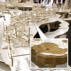 Our look at Worldscape, from Atmos Studio, at 100% design. The flat-packable table seats 80 diners around a relief map of the world and is created from CNC cut plywood.