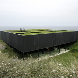 The desire to interfere as little as possible with the visual topography of the landscape prompted to attach the house to the ground and find façade and roof solutions with a direct relationship to the surroundings. OS House by NOLASTER