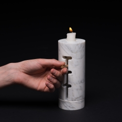 Odnosvechnik, candle holder with an adjustable base, move it higher to keep the flame on the same level, Make a pleasant evening last longer.