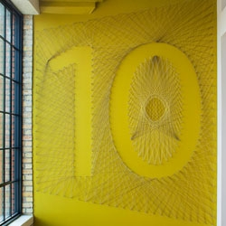 Fun and dynamic typographic environmental graphics by Gensler for the Olson advertising offices in Minneapolis. Floor numbers made with string are just one example.