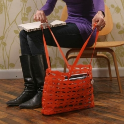 The Ornj Shoulder Bag is made from recycled construction fencing
