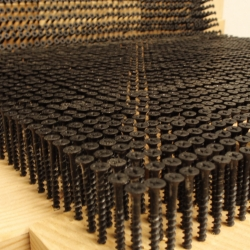 Screw Chair by Revol Design. It is made from 3,726 drywall screws and a bunch of wooden blocks.