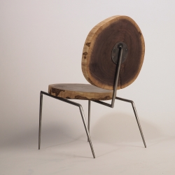 Lounge chair made of reclaimed walnut and steel. Designed and made by Daniel Kaufman, a student at Carnegie Mellon University.