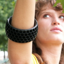 Honeycomb bracelet in black ABS made with a makerbot cupcake cnc.  By Clint Rinehart (prototypist).