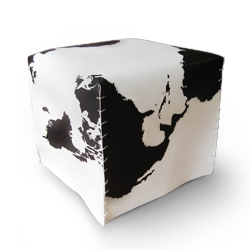 "Cowhere is a pouf lined with a printed pvc sheet, the ""cow effect"" given by a drawing of the world map. By the Italian Zpstudio"