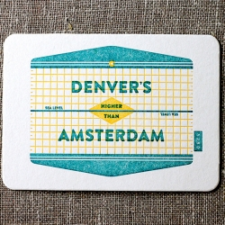 Denver's Higher Than Amsterdam letterpress postcard from Paper Plates Press celebrates geography and the local culture of both cities.