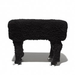 These stools are made from a whole lamb hide, exposing all the details remaining of the former life of the animal.