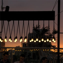 Beautiful outdoor lighting by .PSLAB for Iris, a rooftop bar in Beirut.