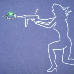Continuing the tee theme, Swarovski rhinestone detailing delivers an explosive muzzle flash as rhinestone shell casings eject from the rear of the gun.