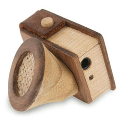 In a curious fusion of functions, this handmade wooden speaker, with a design based on a gramophone, comes complete with, of all things, an in-built pencil sharpener.