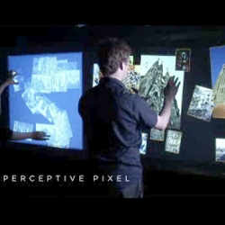 you know how sci fi movies promised us awesome touch screens in the future, a la minority report? well... they exist! Jeff Han's Perceptive Pixel display.