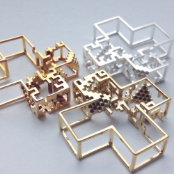Pixel Pendant, reminiscent of an Escher creation, little building blocks and intertwining wires work together to complete the symbol of positivity. 3D printed with Shapeways, designed by Lucas Goossens.