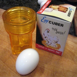 WOW. Although apparently a vintage device, rugenius and i find this amazing tonight ~ go see more images of the great egg cuber packaging as well as video of it in action