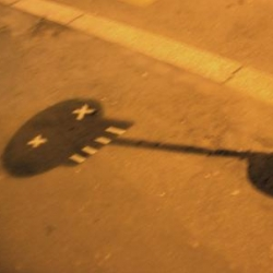 A shadow and some duct tape, found on the road in Milano by Odoardo Fioravanti