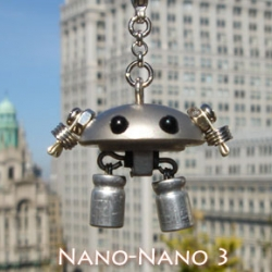 Nano Nano - Phone strap robots by artist Koichi Miyajima created the humorous and nostalgic figure of a human-like robot. Ironically made from the anonymous inorganic parts found in standard electronic goods