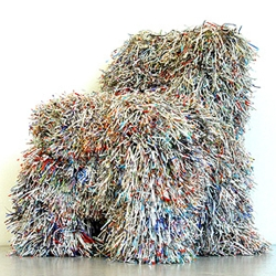 Hairy Chair by Charles Kaiser. shredded paper covering an old chair. watch for paper cuts.