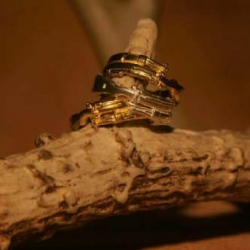 Digby and Iona - Rifle Rings... tiny silver rifles wrapped around your finger...