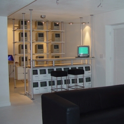 This guys basement Mac Collection is a bit insane... here's the Mac II bar... its an Ikea/Mac  heaven... or hell... depending where you fall on that.