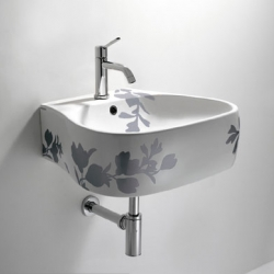 This beautiful sink designed by Patricia Urquiola is named the Sanitary Ware Pear and has a matching toilet and tub!