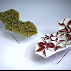 """Origami Chaise Lounges  - by Moroso - Antibodi,  Designer Patricia Urquiola , the design blossoms from a """"cellular""""  genesis of petals sewn in triangular shapes, creating ample patterns."""