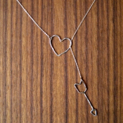 HEART AND ARROW LARIAT by Cynthia Kagoshima. There's something painfully sweet about this piece even i'd wear...