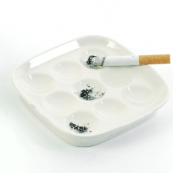 "thrink's  ""O's and X's Ashtray"" for Thorsten Van Elten, 2003. Play tic tac toe with your ashes!!! (Not that I'm encouraging smoking......)"