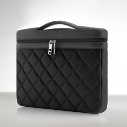 """Knomo - Slim 15"""" handcrafted from full hide leather and nylon twill quilting to protect your laptop from any knocks or bumps. The retractable padded handle makes it comfortable to carry and easy to fit into your bag."""