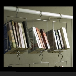 liking the idea of simple book hangers - this is by those guys who did the coffee table where you could hang the magazines/books vertically also creating a table top from the spines.