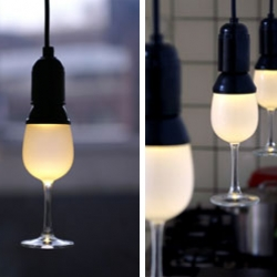 The Glassbulb Light by OOOMS is a lamp shaped like a wineglass. This atmospheric lamp is the perfect lighting for those long romantic evenings accompanied by a nice Bordeaux. The LED's inside will shine for over 30.000 hours.