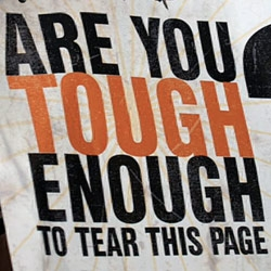 """Are you tough enough to tear this page"" asks an ad in Maxim for ""The Condemned,"" starring Stone Cold Steve Austin... funny video of the AdAge editors actually trying to tear it..."