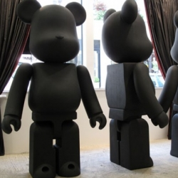 The Comme des Garcons Black Shop comes to Dover Street Market London and for the occasion they created three giant Bearbrick toys for the window, standing 210cm (6.8 feet) tall.