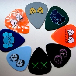 NYC artist Kaws got together with John Mayer to design a series of guitar picks. Really cool!