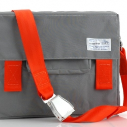 "Forget the ordinary black leather laptop bag, carry your computer in style. This unique bag made by ""All the King's Men""  is complete with a genuine airplane seatbelt shoulder strap."