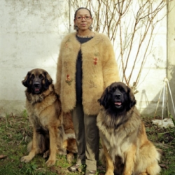 Portraits of people wearing clothes made from the fur of their own dogs! That's right, 'dog wool'.