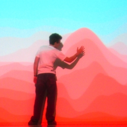 Jay Yan makes amazing interactive video installations. Turbulence - 20 lines of solid color projected on a wall that react to movement.