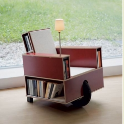 Bookinist is a movable chair designed  for reading. Holds 80 paperbacks and has a reading lamp and hidden compartments(reading-glass, bookmarks, pencil, pencil sharpener and a pocketbock are included)Designed by Nils Holger Moorman