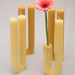 The candle is burnt to the halfway point to expose a double vase into which flowers can be placed. It comes in two different shades of yellow. Candle burn time of approx. 8 hours. By Spinifex.