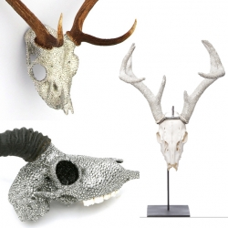 Unrelated artists Peter Prcilio and Suzan Fellman both had the idea to bling out animal skulls with Swarovski Crystals. One on the skull, the other on the horns.