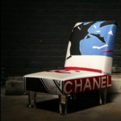 Suzan Fellman's slipper chair with acrylic legs is made from vintage Chanel scarves.  Cozy and chic.