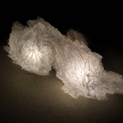 The Soma light sculptures. In Greek, Soma means body and in Hebrew refers to blindness, emanates poetic bodies of light which have the appearance of immaterial foggy landscapes..
